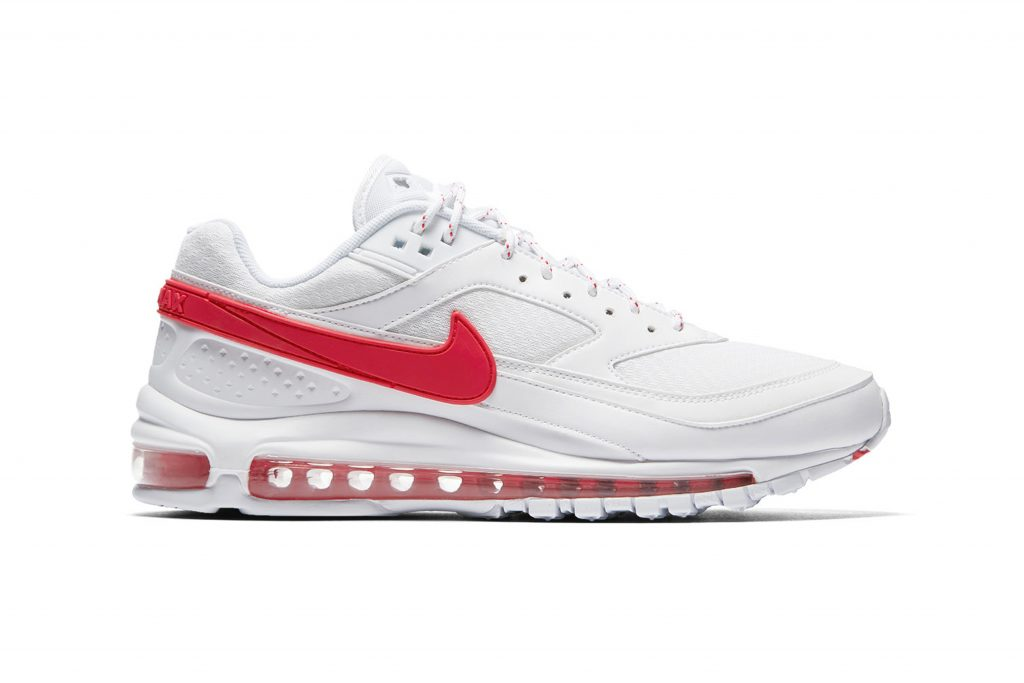 """87589b0971 The clean """"Summit White"""" uppers are offset with flashes of color, with red  appearing on the right shoe's Swoosh, air unit and footbed while a """"Hyper  Cobalt"""" ..."""