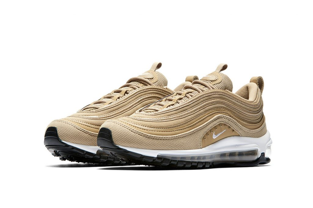 260e9bf78e The Nike Air Max 97 is back in a brand new colorway. Its striped upper sees  metallic gold throughout with white added to the midsole.