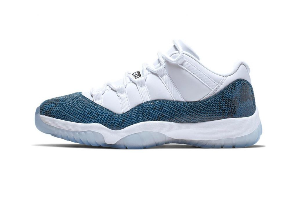"73265f9d702fd1 The ever-so-popular Air Jordan 11 Low has shed its old skin to come out in  a ""Navy Snakeskin"" iteration. Wrapping itself around the signature  mudguard"